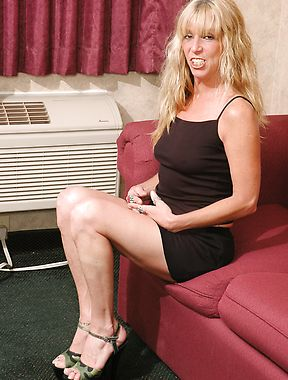 Tanned milf enjoys posing solo and slutty in home pics