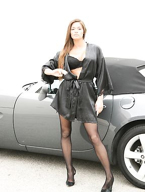 Busty milf in a sexy pictorial next to a sport car
