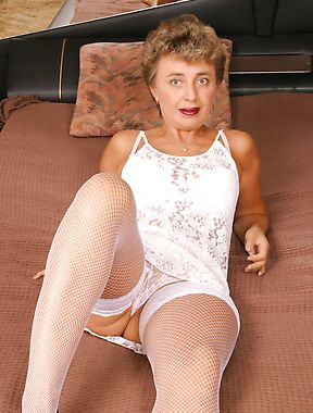 Short-haired mature women in stockings show cunt