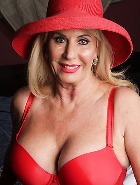 Mature lady in red nude solo