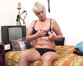 Fat ass granny slides toys in her cramped love holes