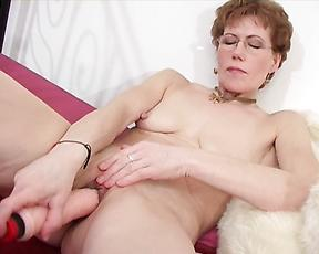 Closeup masturbation with the new toy for a naked mature