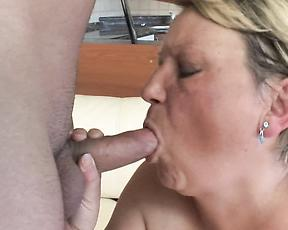 Chubby blonde woman enjoys the company of a younger hunk