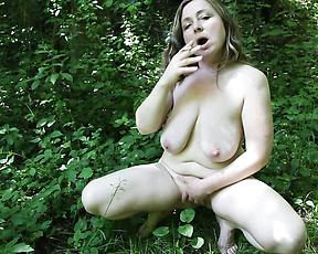 Smoking mature finger fucks pussy in the outdoor
