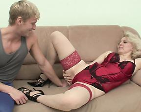 Blonde MILF fucking with strong boy