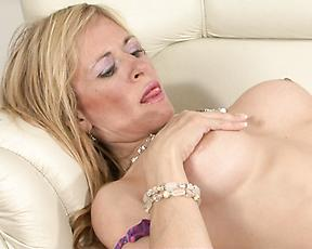 Busty milf rides cock hard and ends up swallowing