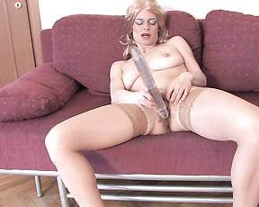 Mature on high heels tries huge dildo in solo action