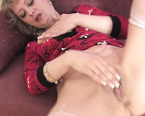 Amateur mature goes pretty harsh on her wet pussy