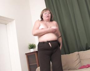 Chubby mature woman strips naked and begins to masturbate