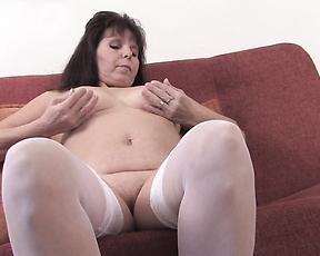 Horny mature finger fucks pussy on the couch in raw solo