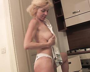 Busty nude granny plays with her moist pussy in kinky solo scenes