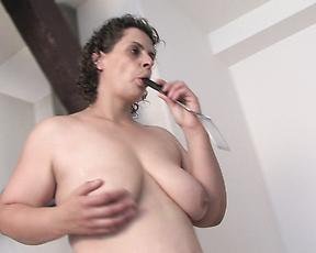 Chubby mature works huge dildo in her fat pussy