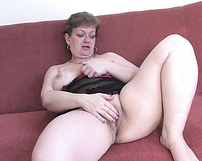 Chubby nude mature works her fat pussy big time