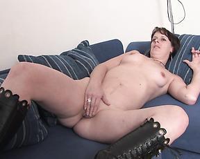 Slutty mom smacks both holes with stiff toy cocks