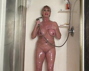 Naked mature with huge tits, insane shower masturbation