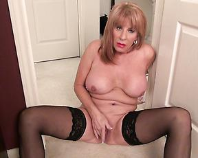 Mature in black stockings, finger fucking solo at home