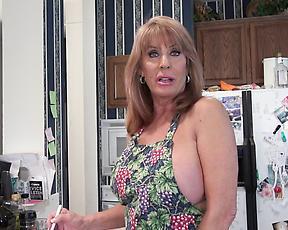 Mature rubs chocolate on her big tits before masturbating