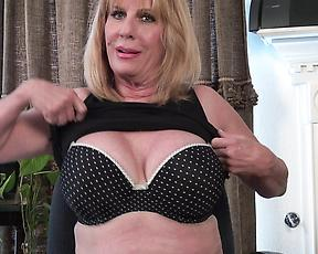 Granny plays with her big tits in insane solo scenes