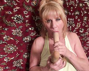 Mature drives massive dildo into her pink cherry