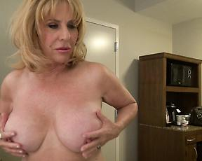 Busty cougar mature looks incredibly hot and horny