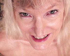 Blonde granny shows off her saggy tits on cam