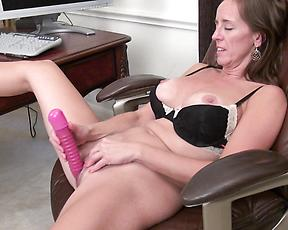 Sexy cougar masturbated in office