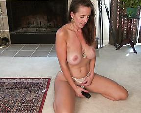 Busty milf tries her new toy for a session of solo