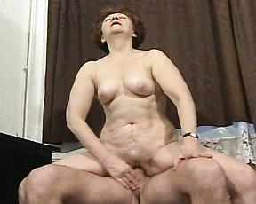 Busty mature loves riding such a young cock
